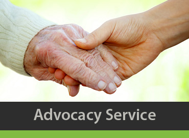 Woman holding elderly woman's hand-advocacy service